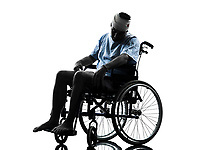 one injured man in wheelchair sleeping in silhouette studio on white background