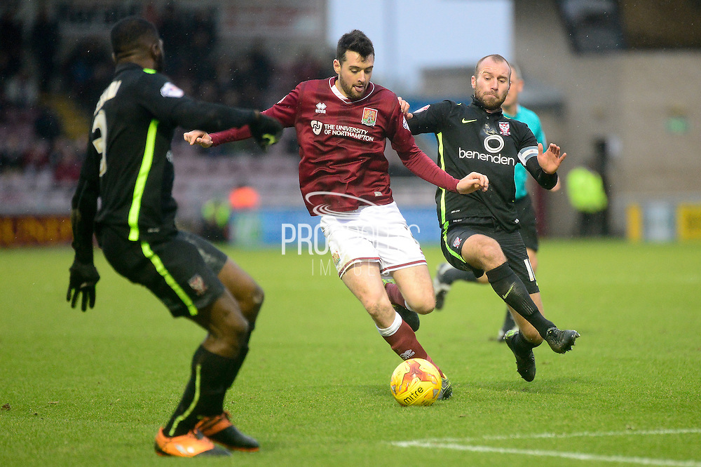 Northampton Town Defender Brendan Maloney splits the York defence during the Sky Bet League 2 match between Northampton Town and York City at Sixfields Stadium, Northampton, England on 6 February 2016. Photo by Dennis Goodwin.