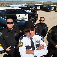 092713  Adron Gardner/Independent<br /> <br /> A.J. Noriega, left, Sheriff Felix Begay, Patrick Largo and Johnson Lee post for a portrait with the new fleet of Ford Utility Interceptor vehicles at Law Enforcement Center in Gallup Friday.