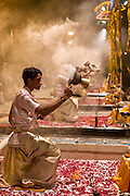 Hindu priests at Ceremony of Light at Shivrati Festival in Holy City of Varanasi, Benares, India