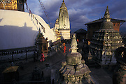 "Perched on top of a hill on the western edge of the Kathmandu Valley, the ancient Swayambunath Stupa (known as the ""Monkey Temple"") is Kathmandu's most important Buddhist shrine. The sleepy, all-seeing Buddha eyes that stare out from the top have become the quintessential symbol of Nepal.<br /> <br /> Founded about 2,000 years ago, Kathmandu Valley was filled with a great lake, and according to Buddhist legend, a single perfect lotus grew in the center of the lake. When the bodhisattva Manjusri drained the lake with a slash of his sword, the lotus flower settled on top of the hill and magically transformed into the stupa.Hence it is known as the Self-Created (swayambhu) Stupa."
