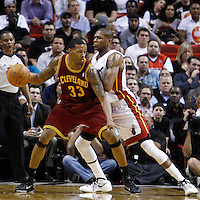 24 January 2012: Miami Heat small forward James Jones (22) defends on Cleveland Cavaliers small forward Alonzo Gee (33) during the Miami Heat 92-85 victory over the Cleveland Cavaliers at the AmericanAirlines Arena, Miami, Florida, USA.