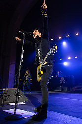 © Licensed to London News Pictures. 21/08/2013. London, UK.   Green Day performing an intimate pre-Reading & Leeds Festivals warmup gig at Brixton Academy, in advance of their headline performances at the festivals this coming weekend.  In this pic - Billie Joe Armstrong.  Green Day is an American punk rock band formed in 1987. The band consists of lead vocalist and guitarist Billie Joe Armstrong, bassist and backing vocalist Mike Dirnt, drummer Tré Cool and guitarist and backing vocalist Jason White.  Photo credit : Richard Isaac/LNP
