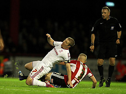 Brentford's Jake Bidwell fouls Middlesbrough's Grant Leadbitter - Photo mandatory by-line: Robbie Stephenson/JMP - Mobile: 07966 386802 - 08/05/2015 - SPORT - Football - Brentford - Griffin Park - Brentford v Middlesbrough - Sky Bet Championship
