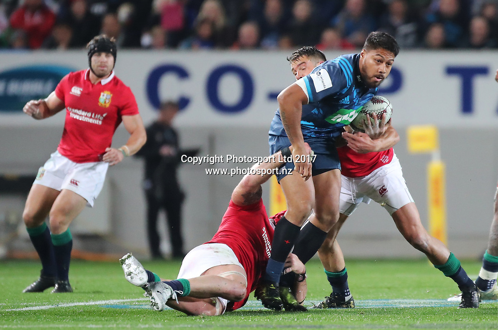 Blues centre George Moala is tackled during the Blues vs British and Irish Lions match played at Eden Park in Auckland as part of the DHL New Zealand Lions Series 2017. The Blues won 22-16. <br /> Copyright Photo; Peter Meecham/ www.photosport.nz