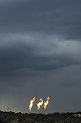 Flaring is a common way to burn off uncaptured methane, during oil and gas production, before it is released into the atmosphere, as seen here at a production facility in Northern New Mexico.