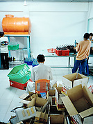 Packing bottles at a fish sauce factory.