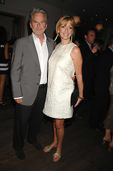TREVOR EVE and SHARON MAUGHAN at a party to celebrate the launch of the Boodles Wonderland jewellery collection held at the Haymarket Hotel, 1 Suffolk Place, London on 9th June 2008.<br />