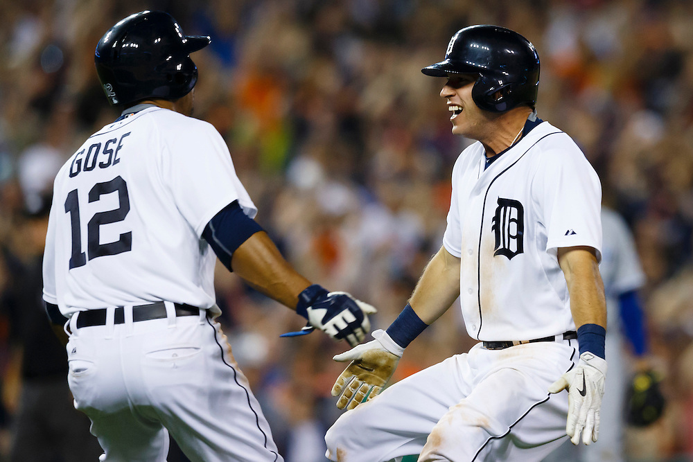 May 8, 2015; Detroit, MI, USA; Detroit Tigers center fielder Anthony Gose (12) and second baseman Ian Kinsler (3) celebrate Kindler bunts for a single scoring Gose in the ninth inning against the Kansas City Royals at Comerica Park. Mandatory Credit: Rick Osentoski-USA TODAY Sports