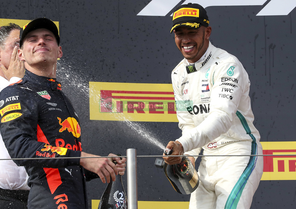 June 24, 2018 - Le Castellet, France - Race winner LEWIS HAMILTON (GBR, Mercedes AMG F1) sprays 2nd place MAX VERSTAPPEN (NLD, Aston Martin Red Bull Racing) with champagne on the podium after the Formula One French Grand Prix, at Paul Ricard circuit.  (Credit Image: © Hoch Zwei via ZUMA Wire)