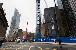 "© Licensed to London News Pictures. 10/03/2016. London, UK. Construction at the site of 22 Bishopsgate in London. If completed, the 62-storey, 295 meter glass and steel tower would become the City of London's tallest ever skyscraper, standing three times the height of Big Ben. But the scheme is under threat following ""right-to-light"" legal discussions with local residents, heritage groups and the owners of neighbouring properties including Tower 42, the Baltic Exchange and St Helen's church. Photo credit : Vickie Flores/LNP"