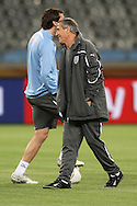 CAPE TOWN, SOUTH AFRICA - 10 JUNE 2010, Uruguay Head Coach Oscar Tabarez shares a joke with Diego Godin during the Uruguay training session held at the Cape Town Stadium. Uruguay play France in their opening game on Friday 11 June 2010. Photo by: Shaun Roy/Sportzpics