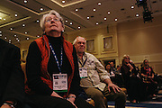 Barbara Ann Dodge from Manassass, Va., listens as Mike Huckabee speaks during day two of the Conservative Political Action Conference (CPAC) at the Gaylord National Resort & Convention Center in National Harbor, Md.