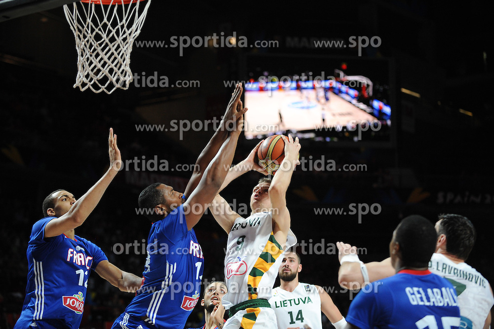 Rudy Gobert and Boris Diaw of France vs Renaldas Seibutis of Lithuania in action during the 2014 FIBA World Basketball Championship Third Place match between France and Lithuania at the Palacio de los Deportes, on September 13, 2014 in Madrid, Spain. Photo by Tom Luksys  / Sportida.com <br /> ONLY FOR Slovenia, France