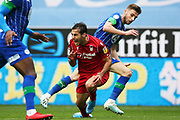Nottingham Forest defender Yuri Ribeiro (2) goes down under the challenge from Wigan Athletic midfielder Joe Williams (20) during the EFL Sky Bet Championship match between Wigan Athletic and Nottingham Forest at the DW Stadium, Wigan, England on 20 October 2019.