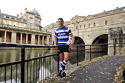 New arrival and rugby league convert Sam Burgess poses in front of Pulteney Bridge during a Bath Rugby photocall - Photo mandatory by-line: Patrick Khachfe/JMP - Mobile: 07966 386802 30/10/2014 - SPORT - RUGBY UNION - Bath - The Recreation Ground - Bath Rugby Photocall with Sam Bugess