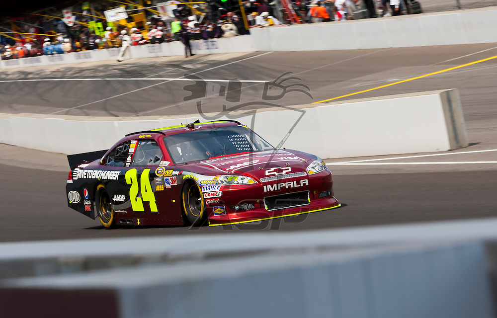 INDIANPOLIS, IN - JUL 29, 2012:  Jeff Gordon (24) brings his car down the front stretch during the Curtiss Shaver 400 presented by Crown Royal Sprint Cup Series race at the Indianapolis Motor Speedway in Indianapolis, IN.