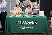 Jinn Bennett, right, and Selena Baker, left, of Well Works, pose at their booth during the 1st Annual Supplier Fair held at Ohio University's Baker Center Ballroom on September 7, 2016.