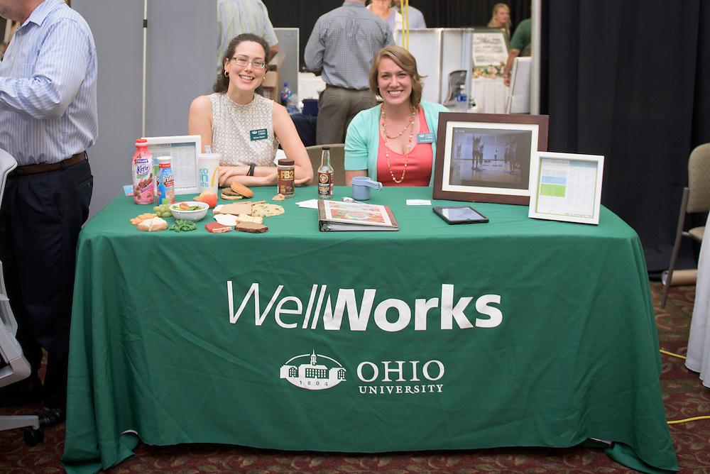 Jinn Bennett, right, and Selena Baker, left, of Well Works, pose at their booth during the 1st Annual Supplier Fair held at Ohio University's Baker Center Ballroom on September 7, 2016.