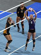 Stanton's Rachel Sorensen (6) sets the ball as Janesville's Emily Ruth (13) and Olivia Fisher (15) look on during the second game of their 1A semifinal match in the state volleyball tournament at the U.S. Cellular Center at 370 1st Ave E on Friday evening, November 12, 2010. (Stephen Mally/Freelance)