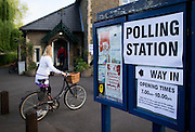 UNITED KINGDOM, London: 7 May 2015,  People arrive to cast there vote for the 2015 Election at a polling station in Barnes, London, England. Andrew Cowie / Story Picture Agency