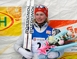 CHANGCHUN, CHINA - SUNDAY, FEBRUARY 25th, 2007: Solli Guro Stroem of Norway celebrates after winning the third prize in the ladies' 1.1 km sprint race at the 2007 FIS World Cup cross-country skiing event. (Pic by Osports/Propaganda)