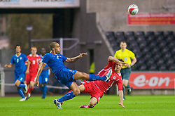 SWANSEA, ENGLAND - Friday, September 4, 2009: Wales' Aaron Ramsey(right) collides with Italy's Guiseppe Bellusci (left) during the UEFA Under 21 Championship Qualifying Group 3 match at the Liberty Stadium. (Photo by Gareth Davies/Propaganda)
