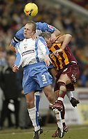 Photo: Aidan Ellis.<br /> Bradford City v Swindon Town. Coca Cola League 1. 11/02/2006.<br /> Swindon's Jack Smith wins the ball from Bradford's Dean Windass