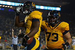 BERKELEY, CA - OCTOBER 06: Running back Brendan Bigelow #5 of the California Golden Bears celebrates with offensive linesman Jordan Rigsbee #73 after scoring a touchdown against the UCLA Bruins during the third quarter at California Memorial Stadium on October 6, 2012 in Berkeley, California. The California Golden Bears defeated the UCLA Bruins 43-17. (Photo by Jason O. Watson/Getty Images) *** Local Caption *** Brendan Bigelow; Jordan Rigsbee