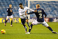 Alan Dunne of Millwall (right) fouls Robert Hall of Bolton Wanderers (left) during the Sky Bet Championship match at The Den, London<br /> Picture by David Horn/Focus Images Ltd +44 7545 970036<br /> 19/12/2014