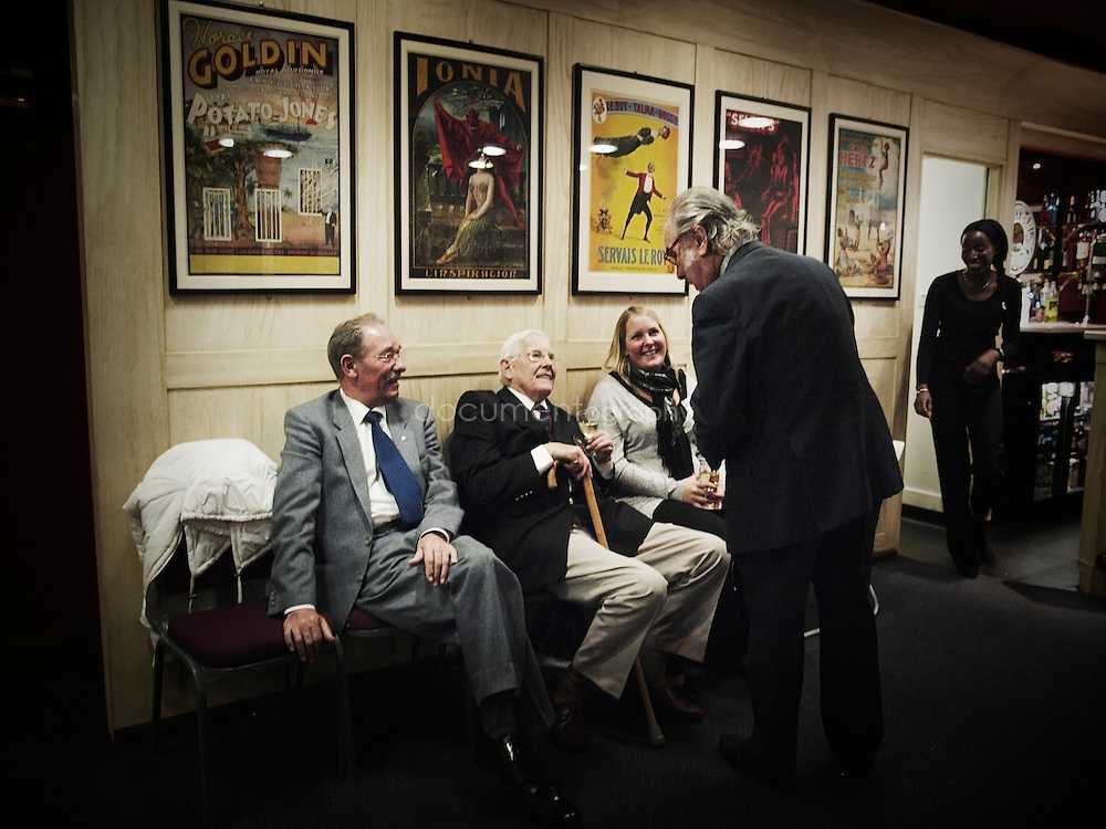 Left to right - Monday Night Host Michael Gurr, our oldest member Fergus Anckorn, who used magic to survive imprisonment by the Japanese during WW2 and Larry Barnes, a well known Pearly King, chat with a prospective lady member who is applying for membership.