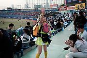 A beer girl takes order at the Jingu Baseball Stadium in Tokyo during during a game Tokyo Swallows VS Hiroshima Carp, Japan. 21/04/2017-Tokyo, JAPAN