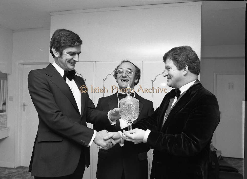 """Car Of The Year Award.    (N58)..1981..22.01.1981..01.22.1981..22nd January 1981..At a reception in Dublin,Mr Enda Hogan, Director and General Sales Manager of Ford Ireland received the """"Car of the Year"""" awardfrom the Chairman of the Irish Motoring Writers' Association. The members of the association voted the new Ford Escort car of the year..Image shows (L-R) Mr Enda Hogan,Director and General Sales Manager of Ford Ireland, Mr Frank Corr, Hon Secretary of the Irish Motoring Writers' Association and Mr Andrew Hamilton,Chairman of the Irish Motoring Writers' Association who made the presentation."""