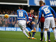 Ipswich Town midfielder Kevin Bru concedes a foul against Queens Park Rangers midfielder Alejandro Faurlín during the Sky Bet Championship match between Queens Park Rangers and Ipswich Town at the Loftus Road Stadium, London, England on 6 February 2016. Photo by Andy Walter.