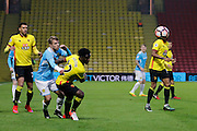 Burton Albion striker Jamie Ward (12) and Watford midfielder Brandon Mason (32) tussle for the ball during the The FA Cup 3rd round match between Watford and Burton Albion at Vicarage Road, Watford, England on 7 January 2017. Photo by Richard Holmes.