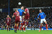 Sean Raggett (20) of Portsmouth battles for possession with Aristote Nsiala (22) of Ipswich Town during the EFL Sky Bet League 1 match between Portsmouth and Ipswich Town at Fratton Park, Portsmouth, England on 21 December 2019.