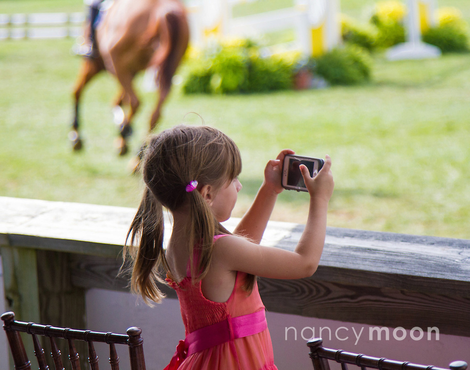 Child shutter-bug photographer at a horse show.<br /> <br /> For all details about sizes, paper and pricing starting at $85, click &quot;Add to Cart&quot; below.