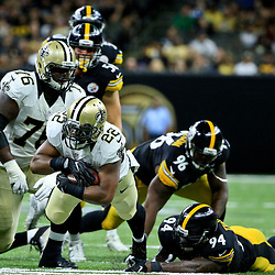 Aug 26, 2016; New Orleans, LA, USA;  New Orleans Saints running back Mark Ingram (22) is tripped up by Pittsburgh Steelers inside linebacker Lawrence Timmons (94) during the first half of a preseason game at Mercedes-Benz Superdome. Mandatory Credit: Derick E. Hingle-USA TODAY Sports