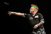 Peter Wright in action during his match with Dave Chisnall  during the Premier League Darts  at the Motorpoint Arena, Cardiff, Wales on 31 March 2016. Photo by Shane Healey.