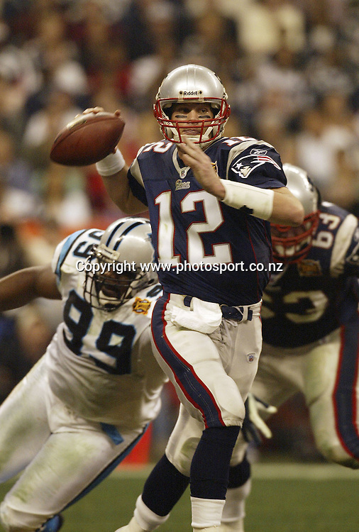 1 Feb 2004:    Tom Brady of the New England Patriots throws on the run during the Pats 32-29 victory over the Carolina Panthers in Super Bowl XXXVIII at Reliant Stadium in Houston, TX.<br />