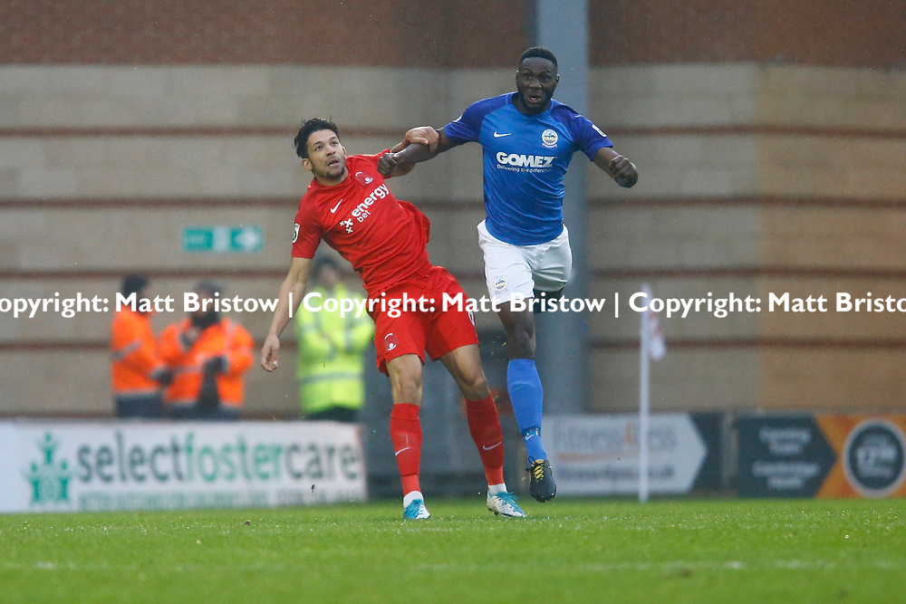 Dover's defender Manny Parry and Leyton Orient's forward Macauley Bonne during the Vanorama National League match between Leyton Orient and Dover Athletic at the Matchroom Stadium, London, England on 18 November 2017. Photo by Matt Bristow.