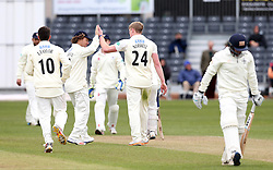 Liam Norwell of Gloucestershire celebrates with Hamish Marshall after taking the wicket of Cameron Steel of Durham MCC University - Mandatory by-line: Robbie Stephenson/JMP - 01/04/2016 - CRICKET - Bristol County Ground - Bristol, United Kingdom - Gloucestershire v Durham MCC University - MCC University Match