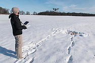 Montgomery, New York - Adam Pass fires his DJI Inspire 1 quadcopter  at Benedict Farm on Jan. 25, 2015.
