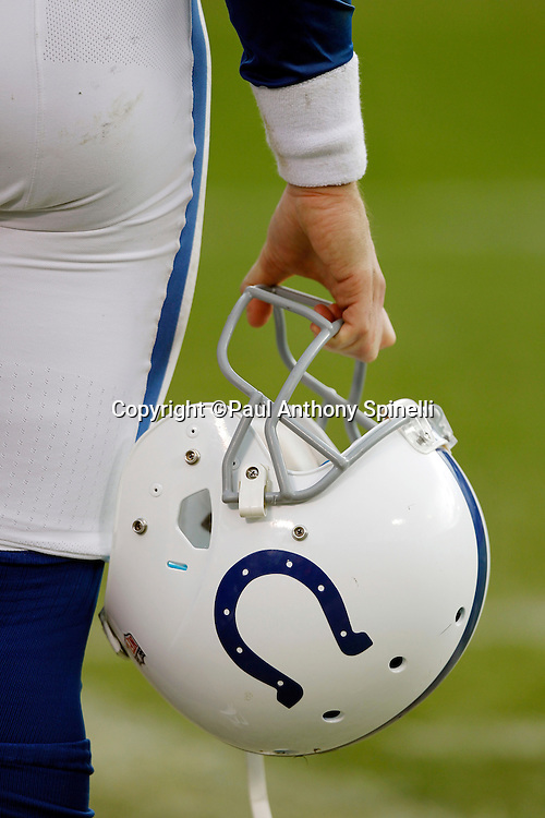 An Indianapolis Colts player holds his helmet during the NFL week 16 football game against the Oakland Raiders on Sunday, December 26, 2010 in Oakland, California. The Colts won the game 31-26. (©Paul Anthony Spinelli)