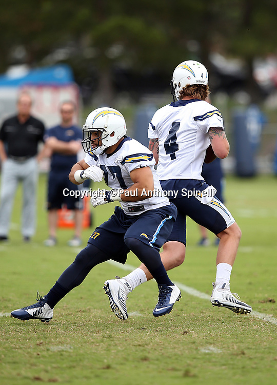 San Diego Chargers rookie running back Adrian McDonald (27) blocks for San Diego Chargers quarterback Zach Mettenberger (4) during the Chargers 2016 NFL minicamp football practice held on Tuesday, June 14, 2016 in San Diego. (©Paul Anthony Spinelli)