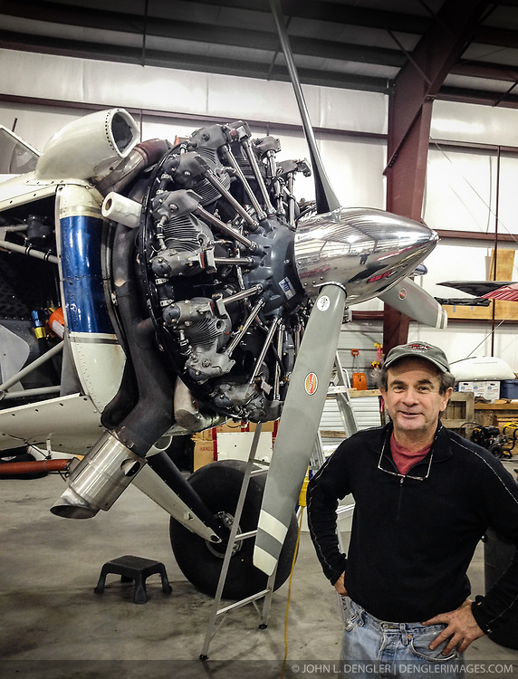 Paul Swanstrom, pilot and owner of Mountain Flying Service, takes a break from servicing his de Havilland Beaver to pose for a photo in his hanger in Haines, Alaska.