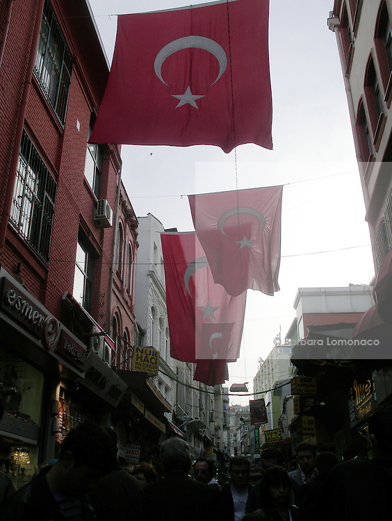 "Istanbul. National flags hanging at the ""suq""."