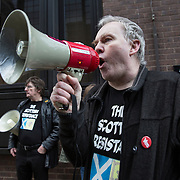 Sean Clerkin (R) of the Scottish Resistance speaking at a demo in Cadogan Street, Glasgow. With fellow member James Scott (L). Picture Robert Perry 29th Jan 2016<br /> <br /> Must credit photo to Robert Perry<br /> FEE PAYABLE FOR REPRO USE<br /> FEE PAYABLE FOR ALL INTERNET USE<br /> www.robertperry.co.uk<br /> NB -This image is not to be distributed without the prior consent of the copyright holder.<br /> in using this image you agree to abide by terms and conditions as stated in this caption.<br /> All monies payable to Robert Perry<br /> <br /> (PLEASE DO NOT REMOVE THIS CAPTION)<br /> This image is intended for Editorial use (e.g. news). Any commercial or promotional use requires additional clearance. <br /> Copyright 2014 All rights protected.<br /> first use only<br /> contact details<br /> Robert Perry     <br /> 07702 631 477<br /> robertperryphotos@gmail.com<br /> no internet usage without prior consent.         <br /> Robert Perry reserves the right to pursue unauthorised use of this image . If you violate my intellectual property you may be liable for  damages, loss of income, and profits you derive from the use of this image.