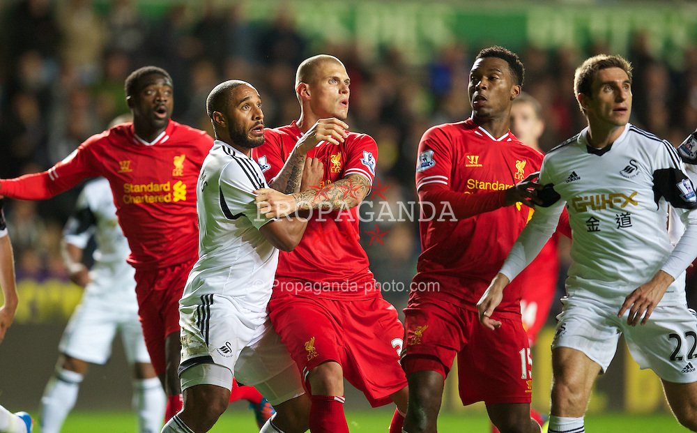 SWANSEA, WALES - Monday, September 16, 2013: Liverpool's Martin Skrtel and Swansea City's captain Ashley Williams during the Premiership match at the Liberty Stadium. (Pic by David Rawcliffe/Propaganda)