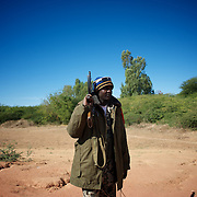 January 21, 2013 - Diabaly, Mali: A Mali army man takes guard on the road outside Diabaly, a day after the government troops regain control of the city. Diabaly was under islamist militants control since the 14th of January...Several insurgent groups have been fighting a campaign against the Malian government for independence or greater autonomy for northern Mali, an area known as Azawad. The National Movement for the Liberation of Azawad (MNLA), an organisation fighting to make Azawad an independent homeland for the Tuareg people, had taken control of the region by April 2012...The Malian government pledge to the French army to help the national troops to stop the rebellion advance towards the capital Bamako. The french troops started aerial attacks on rebel positions in the centre of the country and deployed several hundred special forces men to counter attack the advance on the ground. (Paulo Nunes dos Santos/Polaris)